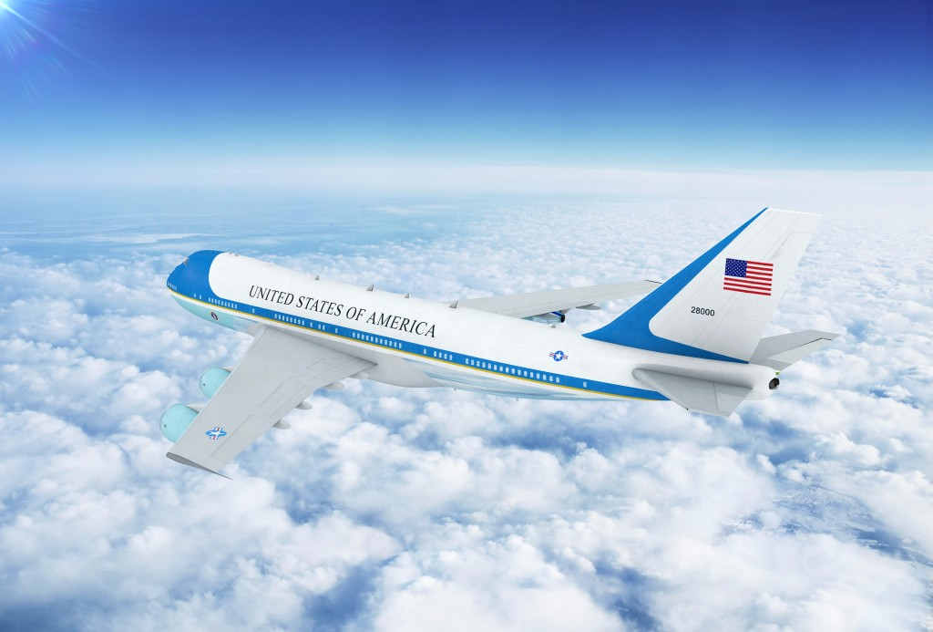 Air Force One, a Boeing 747, flying over cloud