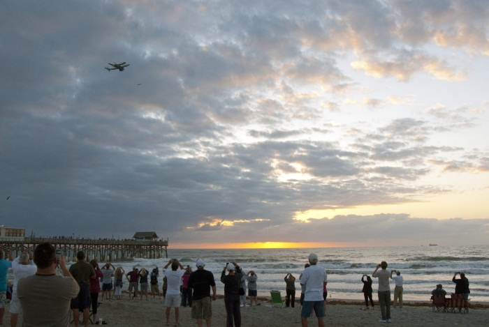 Space Shuttle flys over Florida Beach